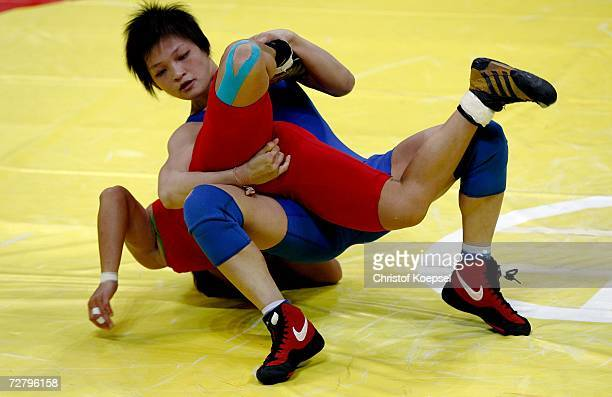 Chiharu Icho of Japan struggles with Kim Hyung Joo of Republic of Korea / in the Women's Freestyle 48kg Gold Medal Wrestling Competition during the...