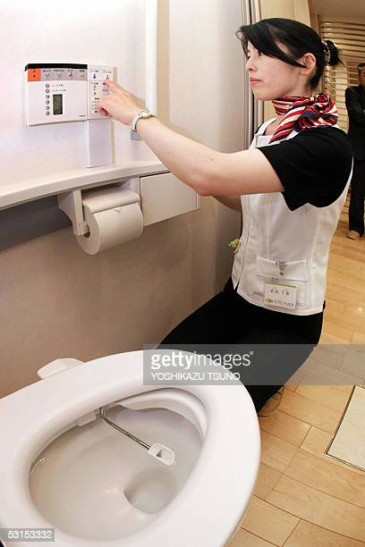 Chiharu Takeda employee of Japan's home builder Daiwa House shows how to use a device of urine protein tester of the latest intelligence toilet...