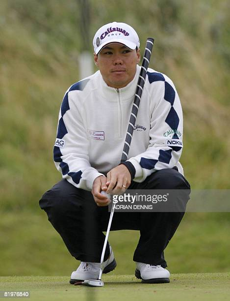 ChihBing Lam of Singapore lines up his putt on the 7th tee on the second day of The Open golf tournament at Royal Birkdale in Southport in northwest...