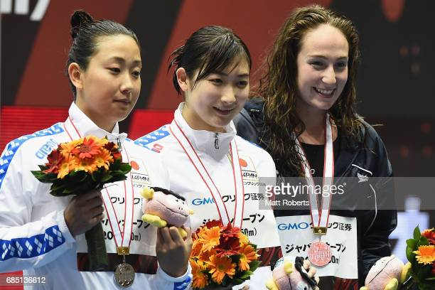 Chihiro Igarashi of Japan Rikako Ikee of Japan and Mikkayla Sheridan of Australia pose with their medals on the podium after the 200m Freestyle Final...