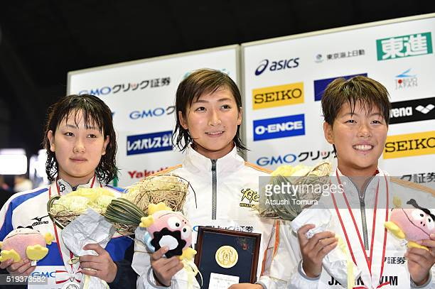 Chihiro Igarashi of Japan Rikako Ikee of Japan and Sachi Mochida of Japan pose on the podium after the Women's 200m Freestyle final during the Japan...