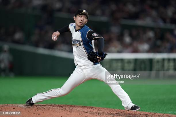 Chihiro Kaneko of the Hokkaido NipponHam Fighters throws during the game between Hokkaido NipponHam Fighters and Oakland Athletics at Tokyo Dome on...
