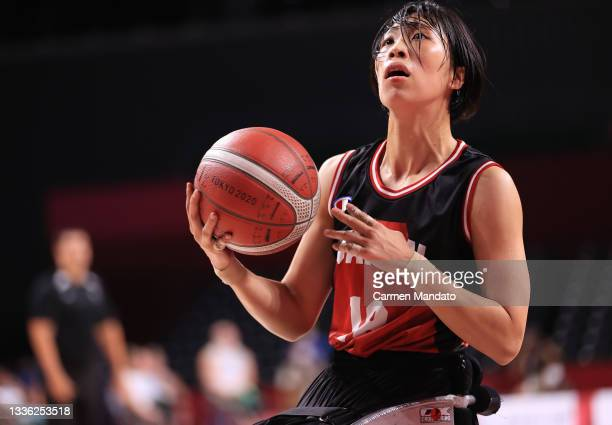 Chihiro Kitada of Team Japan prepares to shoot against Team Australia during the Women's Wheelchair Basketball Group A game on day 1 of the Tokyo...