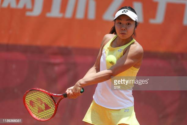 Chihiro Muramatsu of Japan hits a return during her women's singles quarterfinal match against Kaylah Mcphee of Australia at the Kunming Open tennis...