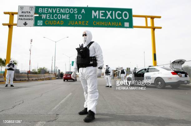 Chihuahua State Police members, wearing protective suits, take part in an information and prevention campaign against the coronavirus -COVID-19-...