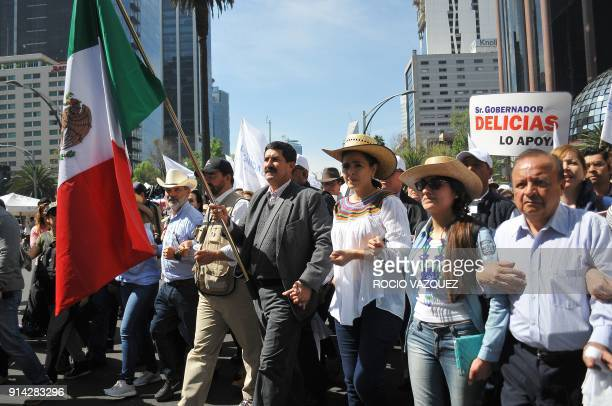 Chihuahua's State Governor Javier Corral marchs during the 'Caravan of Dignity' in Mexico City on February 04 2018 The march aims to demand the...