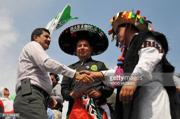 Chihuahua's State Governor Javier Corral shakes hands with a member of the Chamula community during the 'Caravan of Dignity' march in Mexico City on...