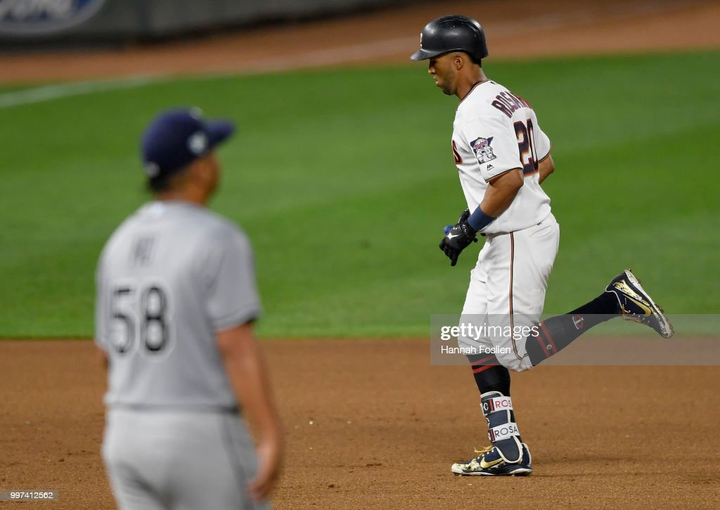 Chih-Wei Hu #58 of the Tampa Bay Rays looks on as Eddie Rosario #20 of the Minnesota Twins rounds the bases after hitting a two-run home run during the seventh inning of the game on July 12, 2018 at Target Field in Minneapolis, Minnesota. The Twins defeated the Rays 5-1.