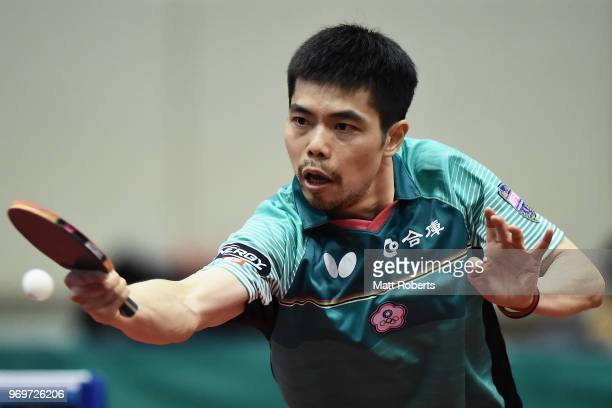 ChihYuan Chuang of Chinese Taipei competes Simon Gauzy of Franc against during the men's singles match on day one of the ITTF World Tour LION Japan...