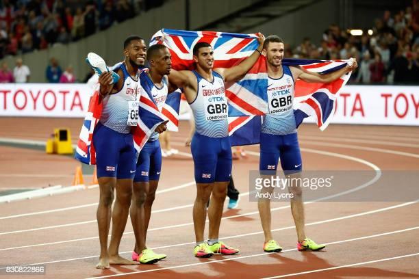 Chijindu Ujah Adam Gemili Daniel Talbot and Nethaneel MitchellBlake of Great Britain celebrate winning gold in the Men's 4x100 Relay final during day...