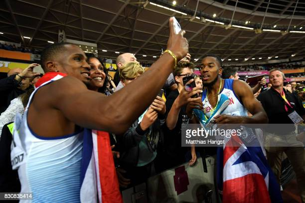 Chijindu Ujah and Nethaneel MitchellBlake of Great Britain celebrate winning gold in the Men's 4x100 Relay final during day nine of the 16th IAAF...