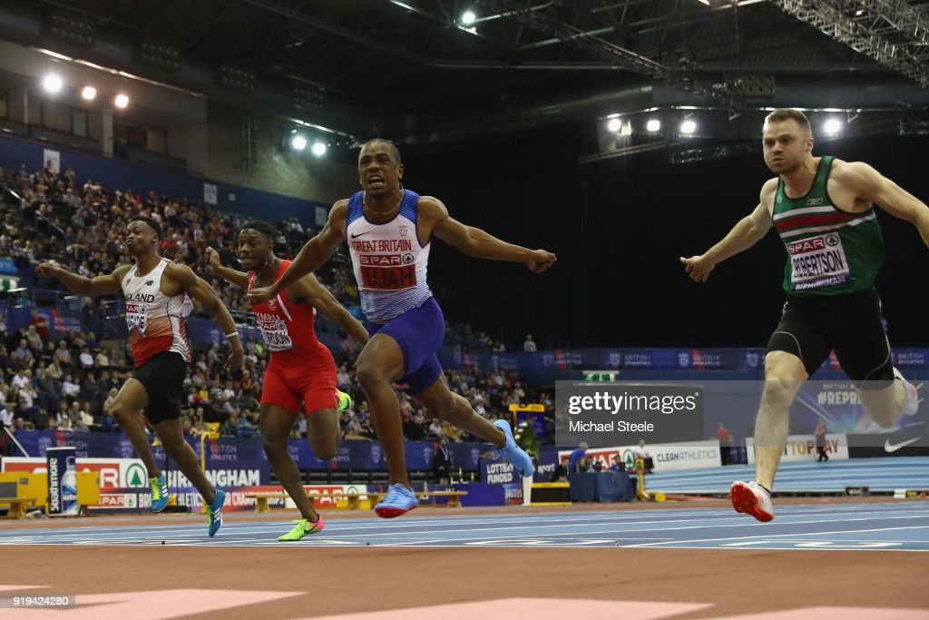 Chijindu Ujah (2R) of Enfield and Haringey Harriers wins the men's 60m final during day one of the SPAR British Athletics Indoor Championships at Arena Birmingham on February 17, 2018 in Birmingham, England.