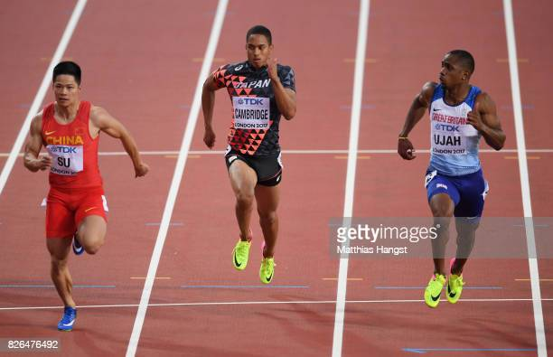Chijindu Ujah of Great Britain Aska Cambridge of Japan and Bingtian Su of China competes in the Men's 100 metres during day one of the 16th IAAF...