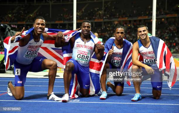 Chijindu Ujah Zharnel Hughes Adam Gemili and Harry AiknesAryeetey of Great Britain celebrate after winning gold in the Men's 4x100 metres relay final...