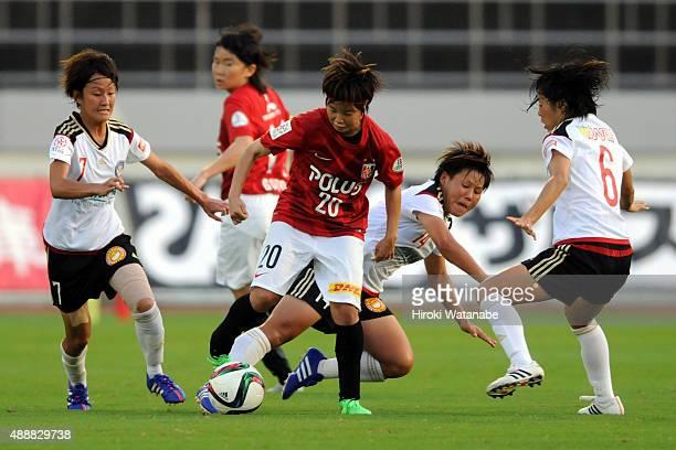 Chika Kato of Urawa Reds Ladies runs with the ball during the Nadeshiko League match between Urawa Red Diamonds Ladies and Okayama Yunogo Belle at...