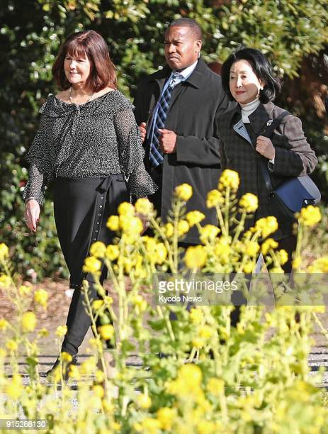 Chikako Aso the wife of Japanese Deputy Prime Minister Taro Aso and Karen Pence the wife of US Vice President Mike Pence walk through the Hamarikyu...