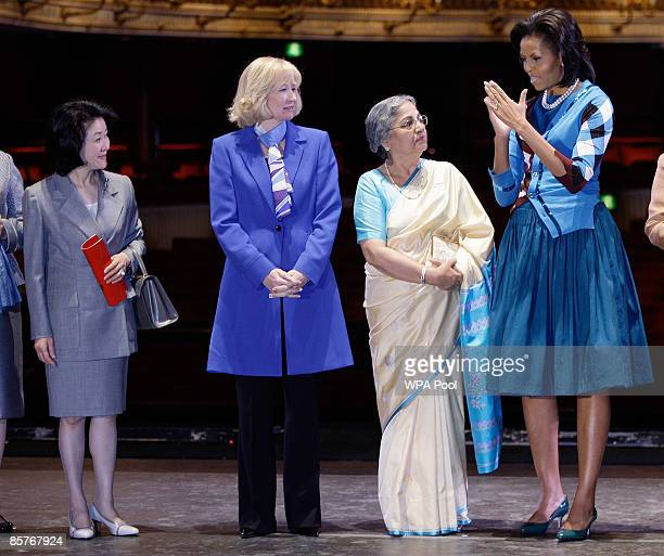 Chikako Aso wife of Japanese Prime Minister Taro Aso and Laureen Harper wife of Canadian Prime Minister Stephen Harper look on as US first lady...