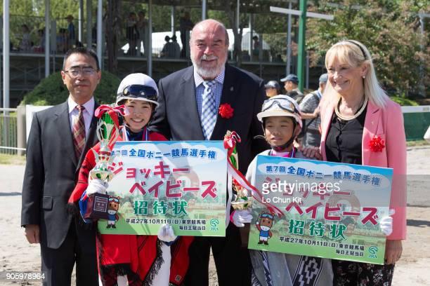Chikane Yoshizawa and Ryuto Yokoyama celebrate after winning the Jockey babies race at Baji Koen JRA's Equestrian Park on September 23 2015 in...