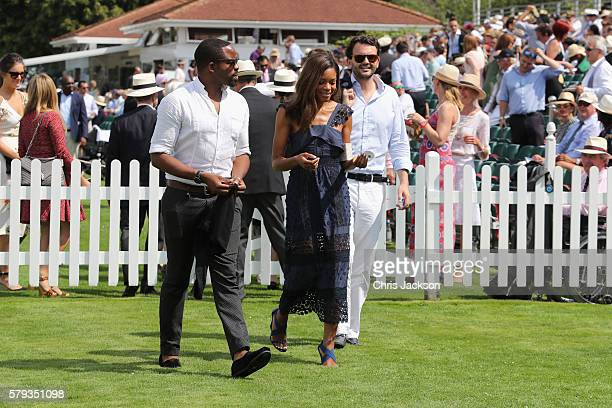 Chike Okonkwo Naomie Harris and Peter Legler attend the Royal Salute Coronation Cup at Guards Polo Club on July 23 2016 in Egham England