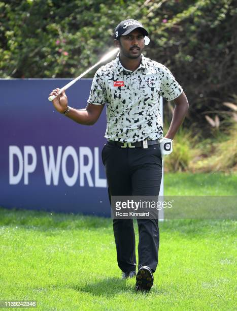 Chikkarangappa of India on the reacts after his shot on the 17th tee during the third round of the Hero Indian Open at the DLF Golf & Country Club on...