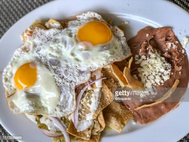 chilaquiles, eggs and beans - mole sauce stock pictures, royalty-free photos & images