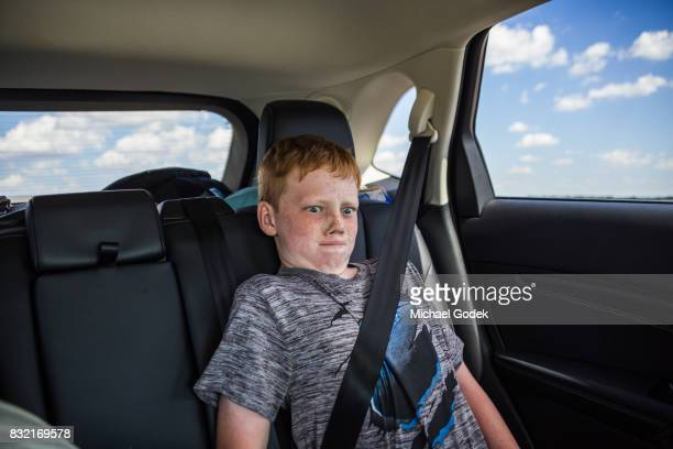 Child acting silly after after hours in the car on a road trip