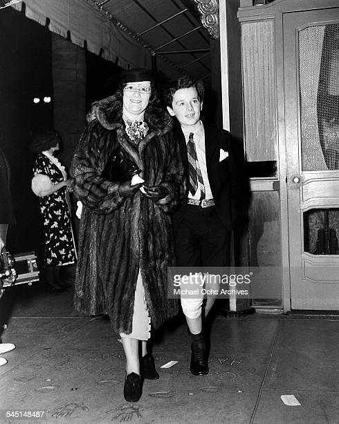Child actor Freddie Bartholomew with his aunt Cissie walk in Los Angeles California