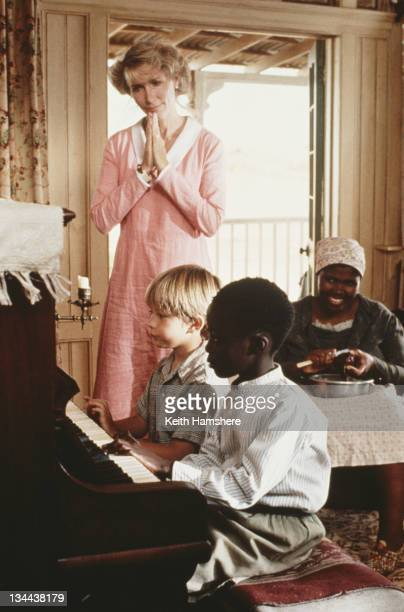 Child actor Guy Witcher as the 7yearold PK American actress Tracy Brooks Swope as his mother Nomadlozi Kubheka as Nanny and Tonderai Masenda as...