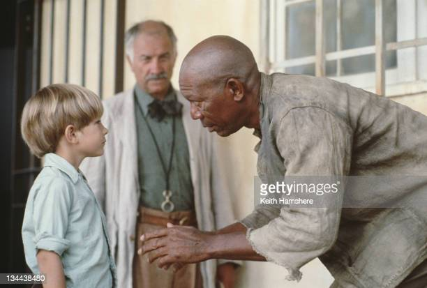 Child actor Guy Witcher as the 7yearold PK and American actor Morgan Freeman as Geel Piet his boxing mentor in the film 'The Power of One' 1992 Actor...