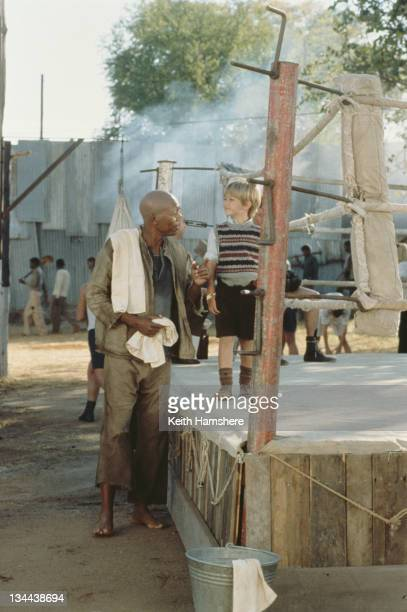 Child actor Guy Witcher as the 7yearold PK and American actor Morgan Freeman as Geel Piet his boxing mentor in the film 'The Power of One' 1992
