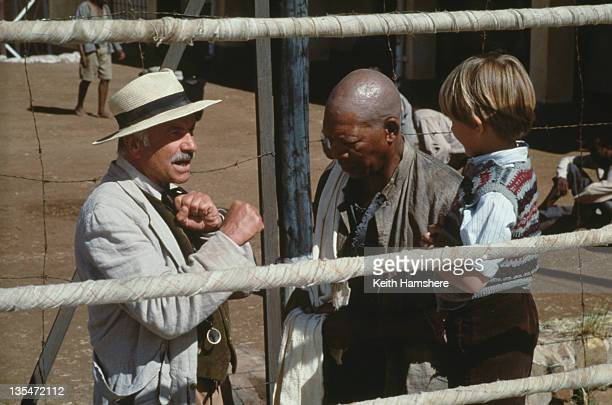 Child actor Guy Witcher as the 7yearold PK with actors Armin MuellerStahl and Morgan Freeman as his mentors in the film 'The Power of One' 1992