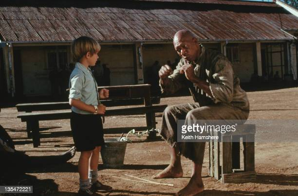 Child actor Guy Witcher as the 7yearold PK with American actor Morgan Freeman as his boxing mentor in the film 'The Power of One' 1992