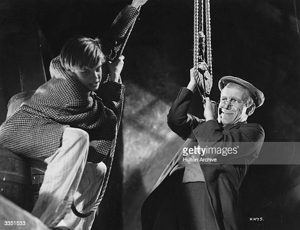 Child actor Tommy Bupp as Bertie Schultz and Will Hay as Dr Benjamin Twist in the film 'Hey Hey USA' directed by Marcel Varnel for...