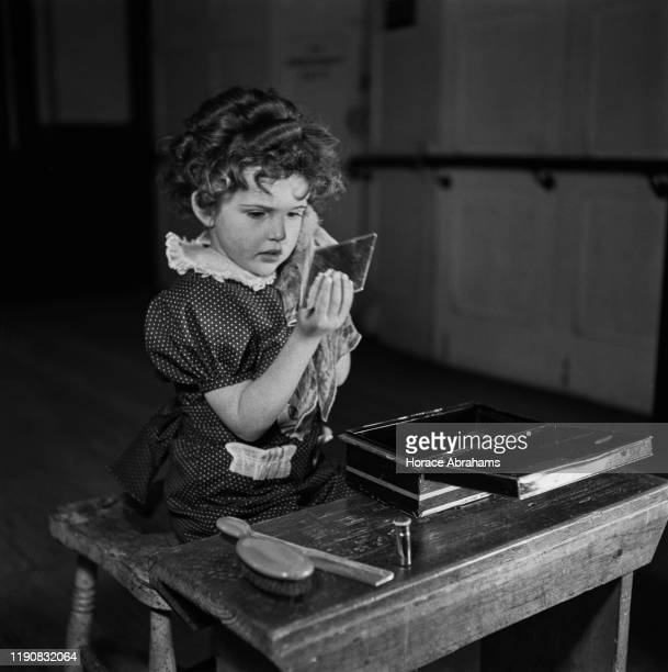 A child actress at her dressing table in England during World War II April 1941