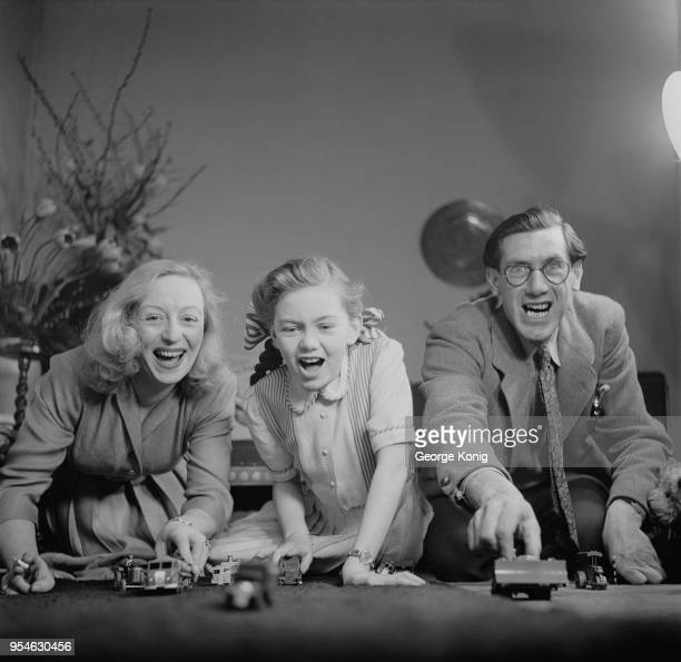 Child actress Janette Scott playing with her parents actress Thora Hird and James Scott at their home UK June 1948
