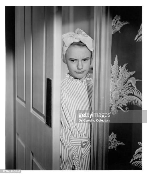 Child Actress Peggy Ann Garner as 'Judy Graves' with a cloth on her hair and standing with a mischievous look by the door in a publicity shot from...