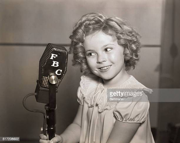 Child actress Shirley Temple holding an FBC microphone Undated photograph ca 193336