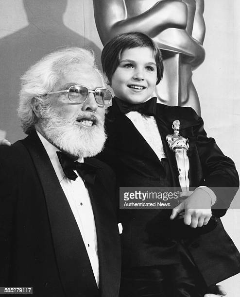 Child actress Tatum O'Neal holding her Best Supporting Actress Oscar with her grandfather Charles O'Neal at the 46th Academy Awards Los Angeles April...