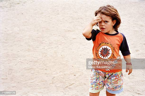 A child affected by the Chernobyl nuclear disaster walks outside a special school for abandoned children in September 2004 in Minsk Belarus Next...