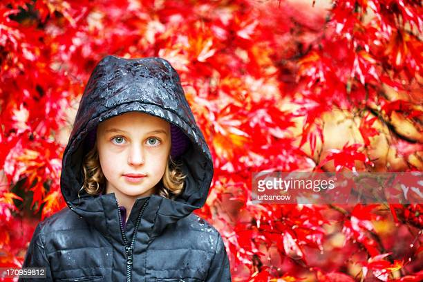 Child against autumnal leaves