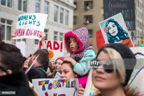 A child among placards at the 2018 Women's March in New York City on January 20 2018