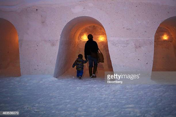 A child and a woman walk inside a snow dome during an event in Kutchan Hokkaido Japan on Saturday Feb 14 2015 Japan had a record number of foreign...