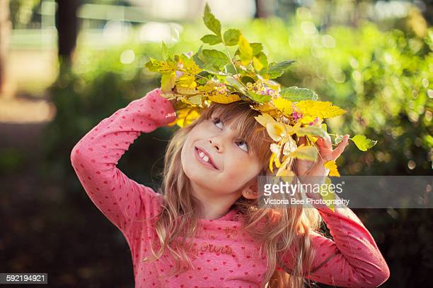 Child and autumn leaves in a park