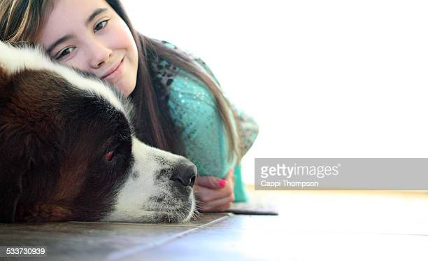 Child and dog laying on floor