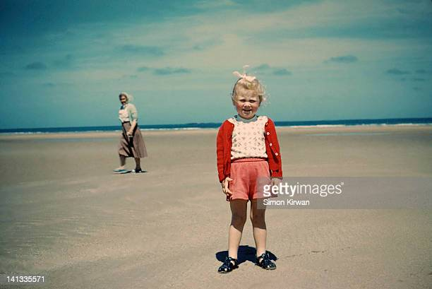 child and grandmother on beach - british granny stock photos and pictures