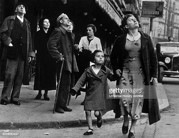 A child and his mother running for shelter from the air raids during the Spanish Civil War This image was taken in Bilbao Spain dated around 1937