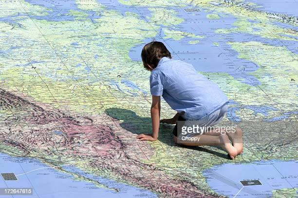 child and map - cartography stock photos and pictures