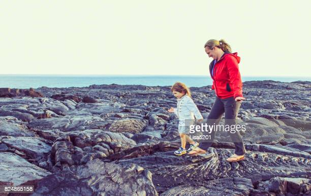 Child and mom explore Volcano Field, Volcano national park