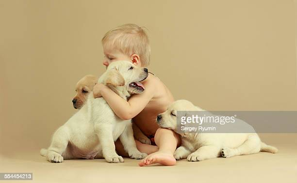 Child and puppies.