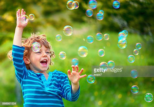 Child and Soap Bubbles